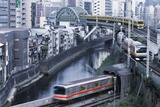 Commuter Trains in Akihabara Photographic Print by Jon Hicks