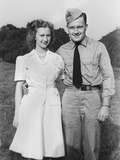 Young Sailor with His Girlfriend, Ca. 1942. Photographic Print by Kirn Vintage Stock