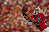 Football Player Catching Ball Photographic Print by  DLILLC