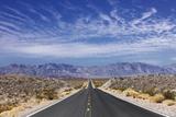 Desert Highway near Death Valley. Photographic Print by Jon Hicks