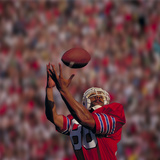 Football Player Catching Football Photographic Print by  DLILLC