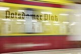 Commuter Train Speeding through Potsdamer Platz U-Bahn Station Photographic Print by Jon Hicks