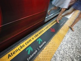 Passengers Stepping out of a Metro Carriage, Rio De Janeiro. Photographic Print by Jon Hicks