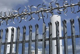 Security Fence Photographic Print by Robert Brook