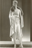 Twenties Female Mannequin Wearing Evening Gown and Fur Collar Photographic Print by Found Image Press