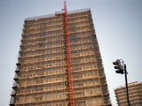 Tower Block Covered in Scaffolding Photographic Print by Robert Brook