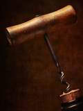 Old-Fashioned Corkscrew Uncorking Bottle Photographic Print by Steve Lupton