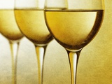 Three Stemmed Gasses of White Wine Photographic Print by Steve Lupton