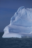 Iceberg Floating in Ocean Photographic Print by  DLILLC