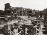 Roman Colosseum and Surrounding Ruins Photographic Print by  Bettmann
