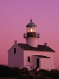 Lighthouse Against a Pink Sky at Twilight Photographic Print by Richard Cummins