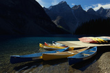 Canoes at Moraine Lake in Banff Photographic Print by W. Perry Conway