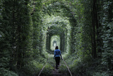 A Girl Walks on a Disused Railway Track, Through What Is known Locally as the -Tunnel of Love- Photographic Print by Gleb Garanich