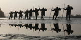 Fishermen Pull a Net Containing Fish from a Lake Photographic Print by Petr Josek Snr