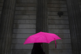 A Woman Carries an Umbrella During a Rain Shower as She Walks Past the Bank of England in London Photographic Print by Andrew Winning