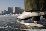 Ice Skates are Pictured on Frozen Alte Donau in Front of Un Headquarters in Vienna Photographic Print by Lisi Niesner