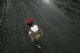 A School Girl Walks on a Road Covered with Oil and Soot at an Industrial Area in Mumbai Photographic Print by Arko Datta