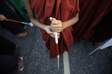 A Visually Impaired Buddhist Novice Monk Holds a Cane Photographic Print by Soe Zeya Tun