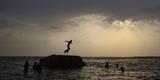 A Boy Prepares to Jump Off a Rock into the Waters of the Osman Sagar Lake Near Hyderabad Photographic Print by Krishnendu Halder