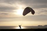 A Paragliding Instructor Arranges His Paraglide Photographic Print by Enrique Castro-Mendivil
