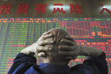 An Investor Looks at an Electronic Board Showing Stock Information, Shanxi Province Photographic Print by China Daily