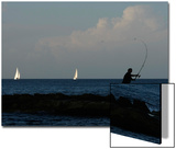Amateur Angler Casts His Fishing Rod as Yachts Sail by in Sliema Prints by Darrin Zammit Lupi