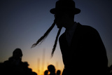 An Ultra-Orthodox Jewish Man Takes Part in the Tashlich Ritual in Ashdod Ahead of Yom Kippur Photographic Print by Amir Cohen