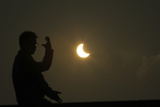 A Man Practices Taichi During an Eclipse at the Bund Along the Huangpu River in Shanghai Photographic Print by Aly Song