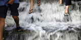 Pedestrians Walk on Steps Leading to the Overflowing Chao Phraya River in Bangkok Photographic Print by Bazuki Muhammad