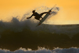 Young Surfer Sails His Board Off a Wave as Large Swells Hit the California Coastline Stampa fotografica di Mike Blake