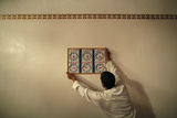 A Muslim Man Places a Table Photographic Print by Jon Nazca
