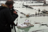 A Man Films an 18th Century Flooded Mosque in Bacallek Near the City of Shkoder Photographic Print by Arben Celi