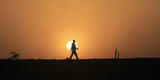 A Labourer Walks Home after Work in Khartoum Photographic Print by Mohamed Nureldin Abdallah