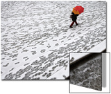 A Woman Walks across a Snow Covered Square in Madrid Prints by Paul Hanna