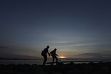A Couple Walk on a Seawall Near Marunda Industrial Estate in Jakarta Photographic Print by Beawiharta Beawiharta