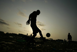 Angolan Youths Play Soccer in the Streets of the Capital Luanda Reproduction photographique par Rafael Marchante