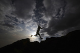 A Local Tourist Jumps at the Santiago Volcano National Park Photographic Print by Oswaldo Rivas