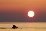 A Couple Rides a Jet Ski in Baska Voda Near Makarska on the Adriatic Sea Photographic Print by Dado Ruvic