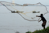 A Fisherman Casts His Net at the Mekong River in Phnom Penh Photographic Print by Chor Sokunthea