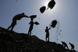 Labourers Load Coal on Trucks at Bari Brahamina in Jammu Photographic Print by Mukesh Gupta