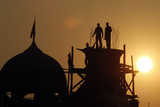 Workers are Silhouetted Against the Setting Sun as They Construct a Minaret on a Mosque in Srinagar Photographic Print by Danish Ishmail