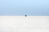 A Man Rides a Bicycle on the Surface of the World's Largest Salt Flat, the Salar De Uyuni Lámina fotográfica por Jorge Silva