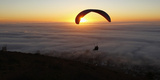 Paragliders Take in the Last of the Day's Light as a Seasonal Fog Engulfs Cape Town Photographic Print by Mike Hutchings