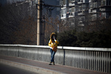 A Woman Wearing a Skull Mask Stands on a Bridge in Central Beijing Photographic Print by David Gray