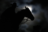 Wrangler Nate Cummins Takes the Opportunity to Ride by Moonlight Photographic Print by Jim Urquhart