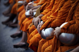 Buddhist Monks Attend an Alms Offering Ceremony in Bangkok's Shopping District Reproduction photographique par Damir Sagolj