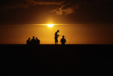 Fishermen Stand on Havana's Seafront Boulevard El Malecon as the Sun Sets Photographic Print by Desmond Boylan