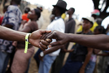 Haitian Volunteers Hold Hands Photographic Print by Jorge Silva