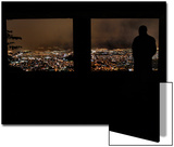 A Man Looks Out at the View of Tegucigalpa at Night Prints by Edgard Garrido