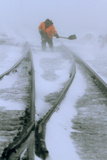 A Worker Clears Snow from a Track During Heavy Snowfall Photographic Print by Eduard Korniyenko